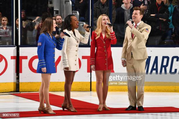 The USO Show Troupe quartet sing the national anthem on Military Appreciation Night prior to a game between the Columbus Blue Jackets and the Dallas...