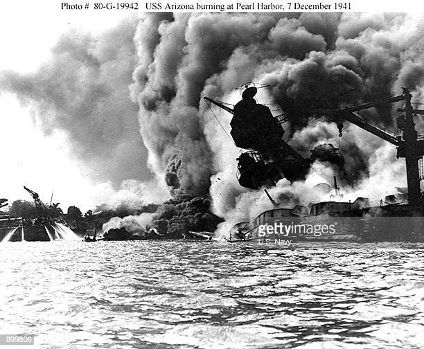 The USS Arizona burns during the bombing of Pearl Harbor, December 7, 1941 in Hawaii.