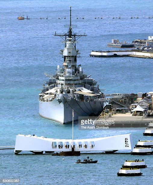 The USS Arizona Memorial and the Battleship Missouri memorial are seen on December 27 2016 in Honolulu Hawaii Abe visits the USS Arizona Memorial...