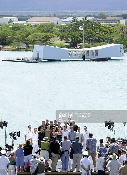 """The USS Arizona Memorial is a backdrop for a cast photo prior to the premiere of their new film """"Pearl Harbor"""" May 20, 2001 on the deck of the USS..."""