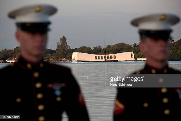 The USS Arizona memorial is seen as a US Marine firing detail stands at attention at the contemplation circle during a memorial service for the 69th...