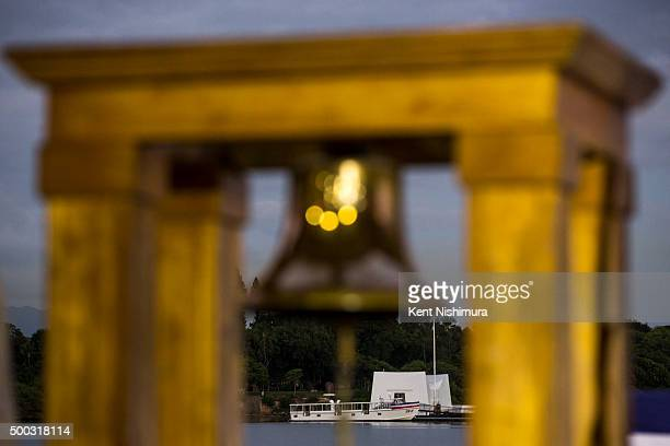 The USS Arizona Memorial sits off of Ford Island during a memorial service marking the 74th Anniversary of the attack on the US naval base at Pearl...