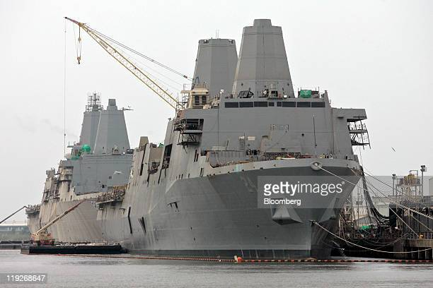 The USS Arlington front and USS San Diego rear both US Navy amphibious transport dock ships sit at the dock at Ingalls Shipbuilding yard a division...