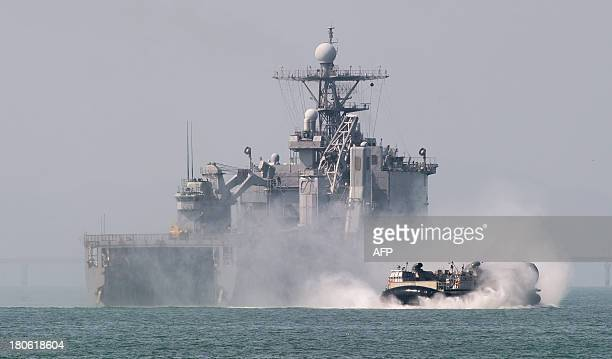 The USS Ashland amphibious ship launches an LCAC landing hovercraft toward Wolmi island at Incheon on September 15 2013 during a reenactment of the...