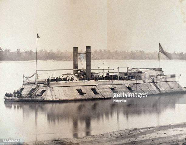 The USS Baron De Kalb possibly the first ironclad constructed in America patrols a river during the American Civil War The boat was formerly called...