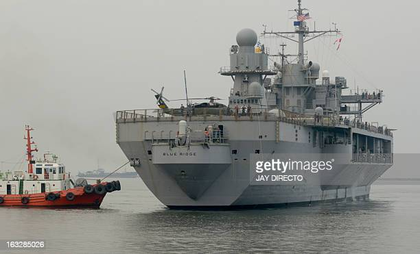 The USS Blue Ridge flagship of the US Seventh Fleet arrives at the port in Manila on March 7 2013 The Blue Ridge the mobile command center of the 7th...