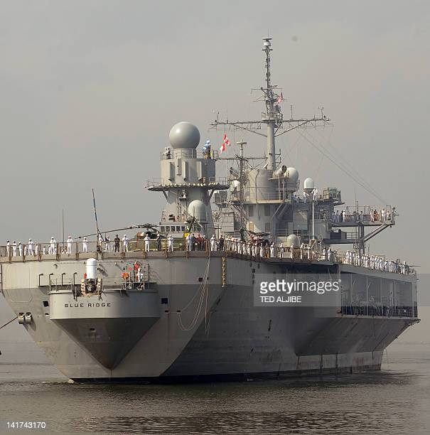 The USS BlueRidge prepares to dock at the international port in Manila on March 23 for a fourday visit The visit comes as Philippine President...