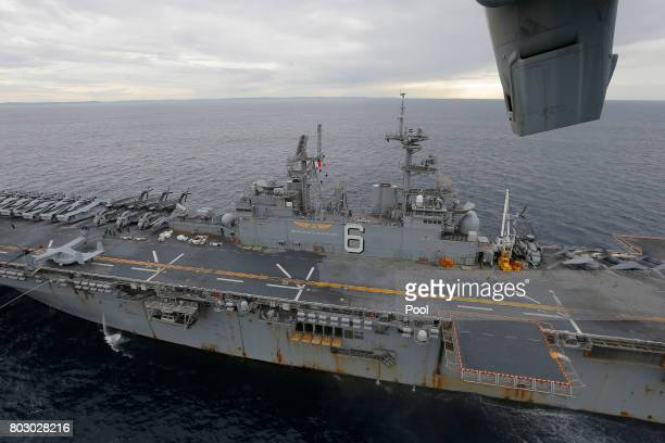 The USS Bonhomme Richard amphibious assault ship sails in the Pacific Ocean off the coast of Sydney Australia June 29 2017 after a ceremony on board...