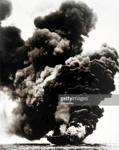 The USS Bunker Hill burning after a Japanese kamikaze suicide attack near Okinawa on 11th May 1945 resulting in 372 dead and 264 wounded. This image...