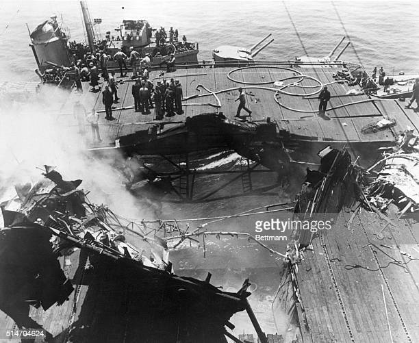 The USS Bunker Hill was heavily damaged when it was hit by a Kamikaze bomb Several pilots were killed when the bomb ripped through the deck to the...