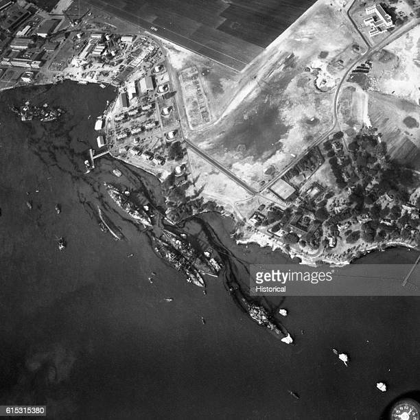 The USS California the USS Maryland the USS Oklahoma the USS Tennessee the USS West Virginia and the USS Arizona show varying degrees of damage...