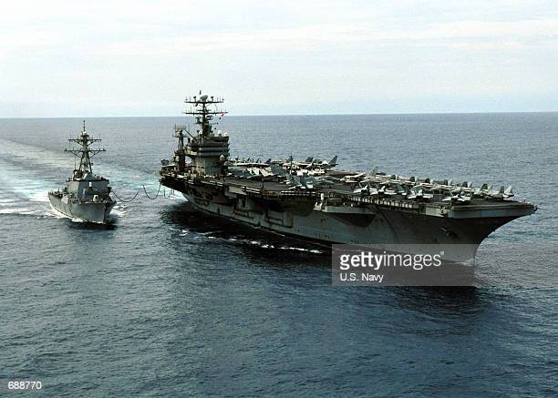 The USS Carl Vinson performs a refueling at sea with the USS O''Kane December 20 2001 while at sea During this refueling operation the USS Carl...