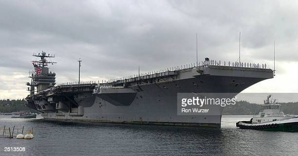 The USS Carl Vinson pulls into port at Naval Station Bremerton September 19 2003 in Bremerton Washington The USS Carl Vinson was returning after...