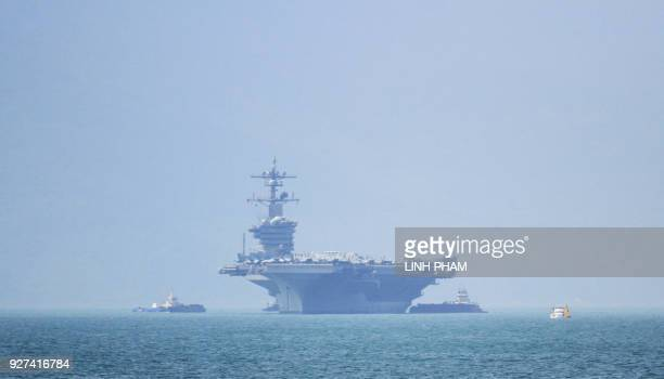 The USS Carl Vinson the US Navy's nuclearpowered Nimitzclass aircraft carrier pulls into port in Danang on March 5 2018 The Carl Vinson arrived in...