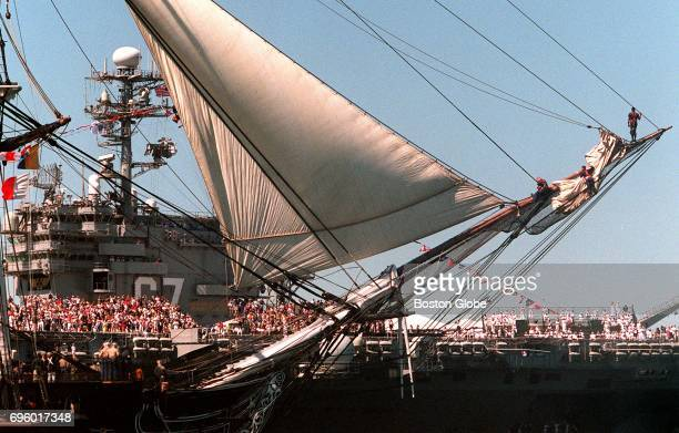 The USS Constitution as it leads the Parade of Sail during Sail Boston on July 11 2000 It is sailing passed the USS John F Kennedy