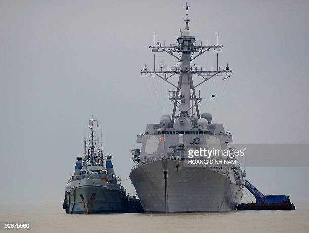 The USS destroyer Lassen is seen anchored along with the 7th Fleet flagship USS Blue Ridge at Tien Sa port in Vietnam's central coastal city of Da...