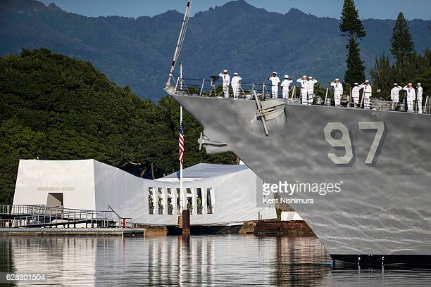 The USS Halsey performs a PassinReview during a ceremony commemorating the 75th anniversary of the attack on Pearl Harbor at Kilo Pier on December 07...
