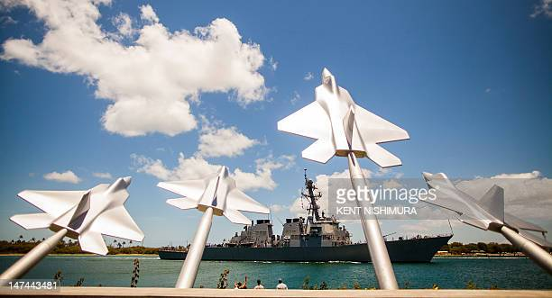The USS Higgins passes the Missing Man Memorial at Aloha Aina Park as it sails into Joint Base Pearl HarborHickam in support of Rim of the Pacific...