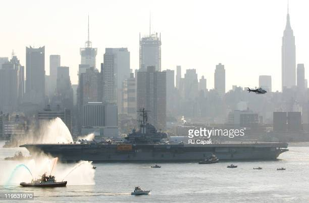 The USS Intrepid being towed out of its Hudson River Anchorage