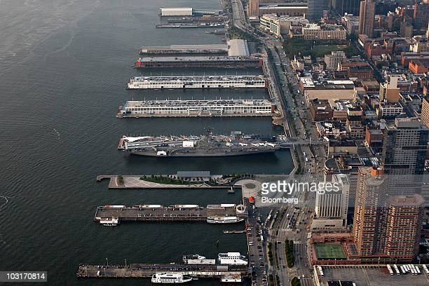 The USS Intrepid center is docked at Pier 86 on the west side of Manhattan in this aerial photo taken over New York US on Wednesday July 7 2010...