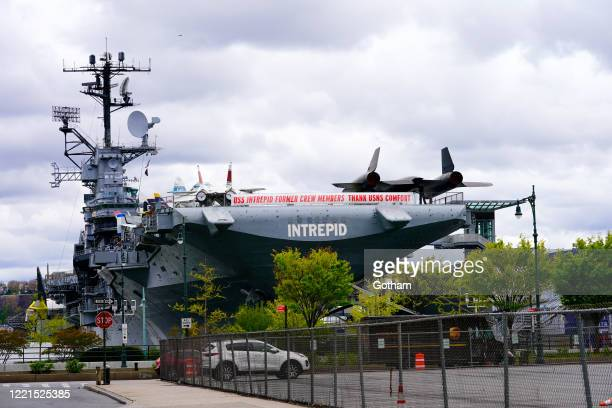 "The USS Intrepid displays a banner that reads, ""USS Intrepid Former Crew Members Thank USNS Comfort"" during the coronavirus outbreak on April 27,..."
