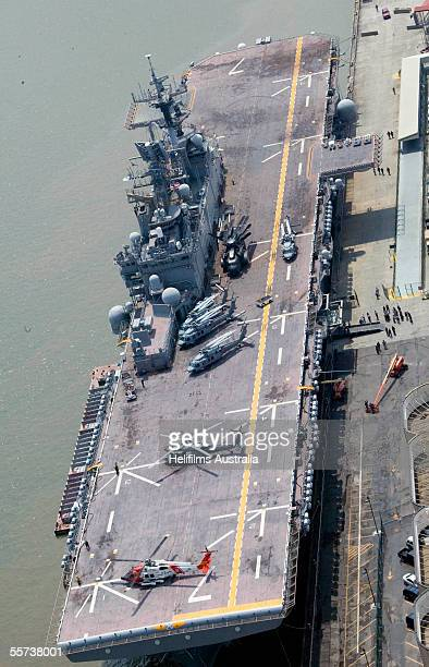 The USS Iwo Jima sits moored alongside the Riverwalk shopping mall as a base for rescue helicopters and to accommodate President George W Bush during...