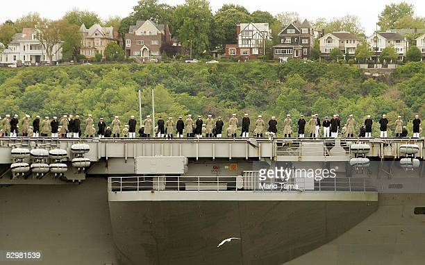 The USS John F Kennedy sails in the Hudson River with New Jersey in the background during Fleet Week May 25 2005 in New York City Fleet Week honors...