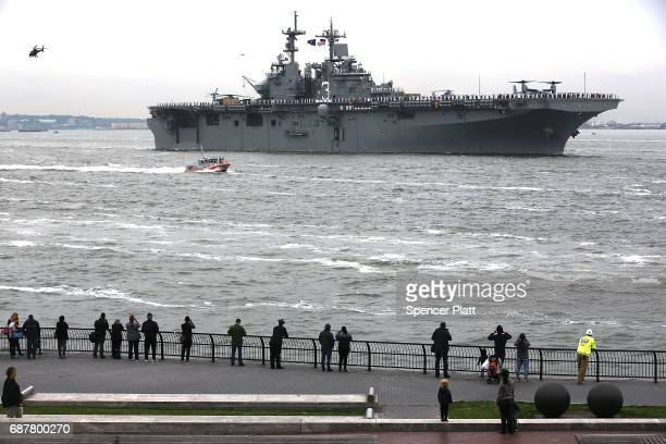 The USS Kearsarge joins The Parade of Ships as it makes its way past the Statue of Liberty on the opening day of Fleet Week on May 24 2017 in New...