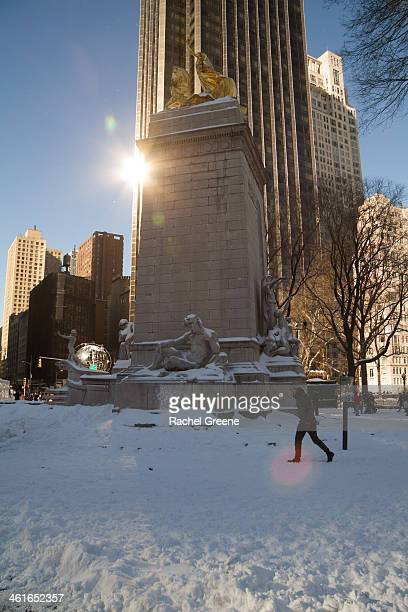 CONTENT] The USS Maine National Monument at the Merchant's Gate entrance to Central Park covered in snow after Winter Storm Hercules