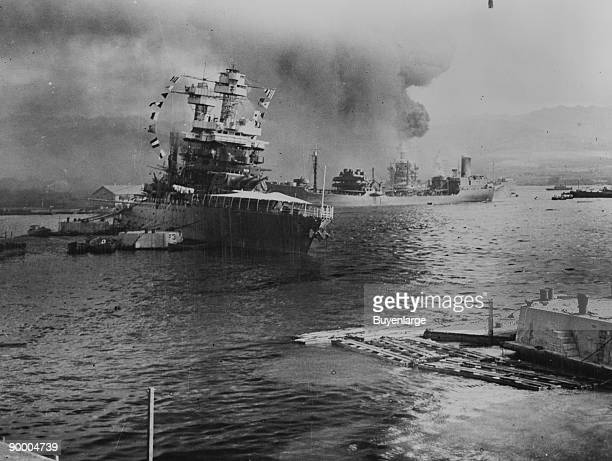 The U.S.S. Neosho, navy oil tanker, cautiously backs away from her berth in a successful effort to escape the Japanese attack on Pearl Harbor, Dec....
