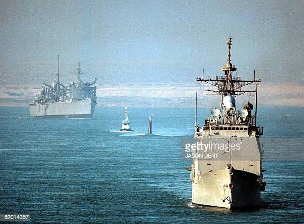 The USS Normandy the submarine USS Annapolis and the support ship USS Seattle all part of the USS George Washington battle group cross the Suez Canal...