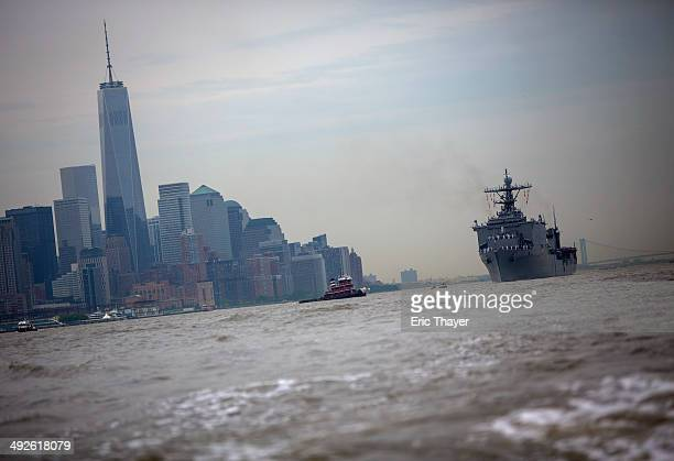 The USS Oak Hill passes One World Trade and the rest of downtown Manhattan on May 21 2014 in New York City Fleet Week festivities officially began...