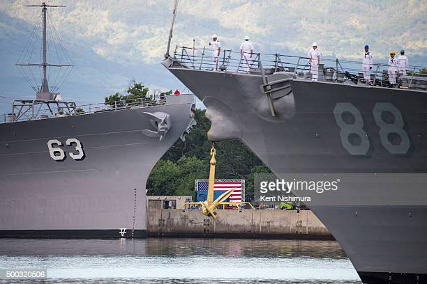 The USS Preble performs a passinreview as it passes the USS Missouri during a memorial service marking the 74th Anniversary of the attack on the US...