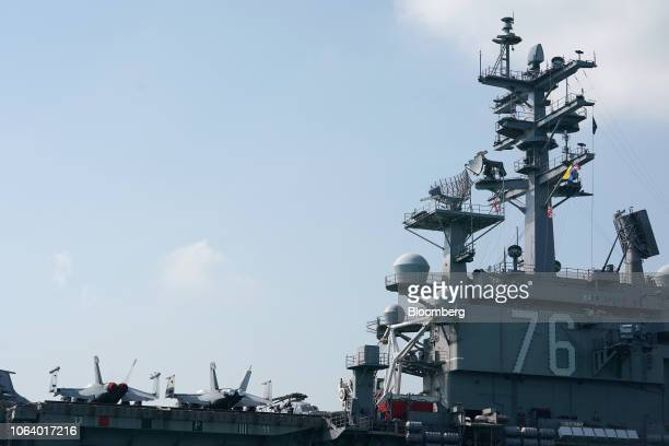 The USS Ronald Reagan, a Nimitz-class aircraft carrier and part of the U.S Navy 7th Fleet, sits anchored in Hong Kong, China, on Wednesday, Nov. 21,...