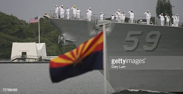The USS Russell performs a pass in review past the USS Arizona Memorial during a moment of silence December 7 2006 in Pearl Harbor Oahu The 65th...