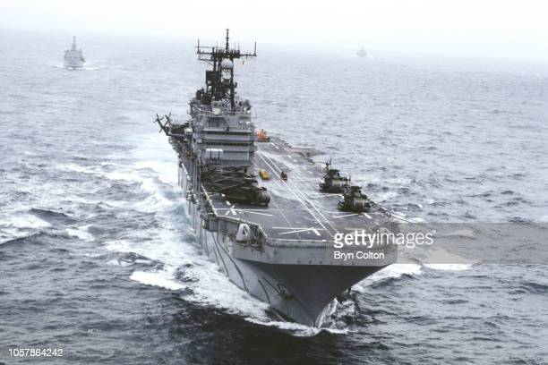 The USS Saipan a Tarawaclass amphibious assault ship of the United States Navy off the Norwegian coast during the NATO exercise Military units from...