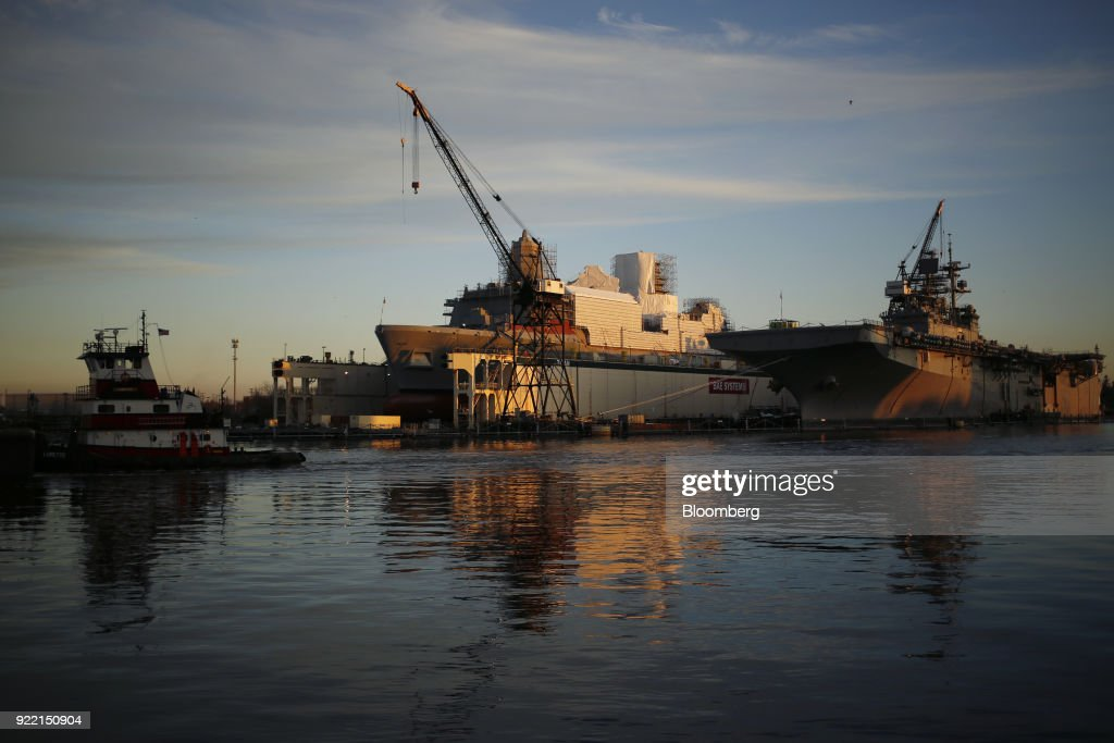 The USS San Antonio (LPD-17), left, and USS Bataan (LHD-5) sit docked at the BAE Systems Plc Norfolk Ship Repair facility on the Elizabeth River in Norfolk, Virginia, U.S., on Tuesday, Jan. 9, 2018. BAE Systems Plc is scheduled to release earnings figures on February 22. Photographer: Luke Sharrett/Bloomberg via Getty Images
