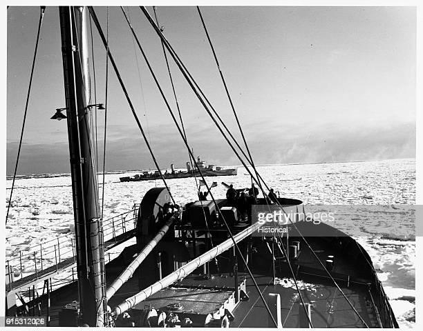 The USS Sapelo faces the USS Geaves across an ice floe en route to Argentia Newfoundland World War II North Atlantic Ocean