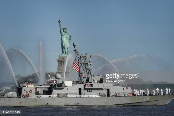 The USS Tornado sails past the Statue of Liberty during the Fleet Week Parade of Ships in New York Harbor May 22 2019 in New York City Now in its...