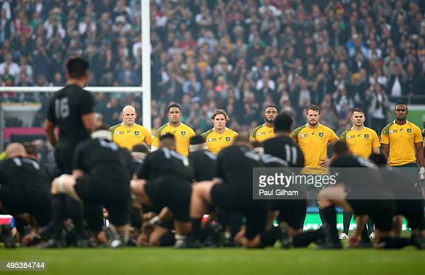 The ustralia team face the Haka prior to kickoff during the 2015 Rugby World Cup Final match between New Zealand and Australia at Twickenham Stadium...