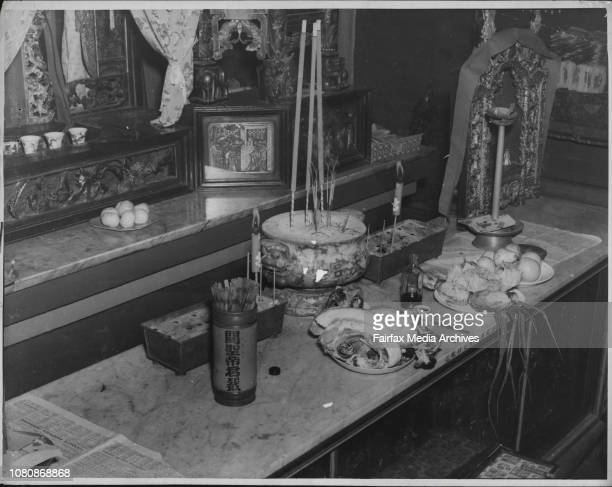 The usual custom of Chinese is to after thanksgiving in the manner of food here shown placed on the altar of a Joss House at Glebe January 29 1949