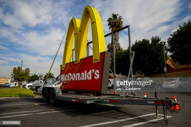 The usual McDonald's sign sits on a trailer in the parking lot of the franchise located at the corner of Long Beach Boulevard and Imperial Highway...