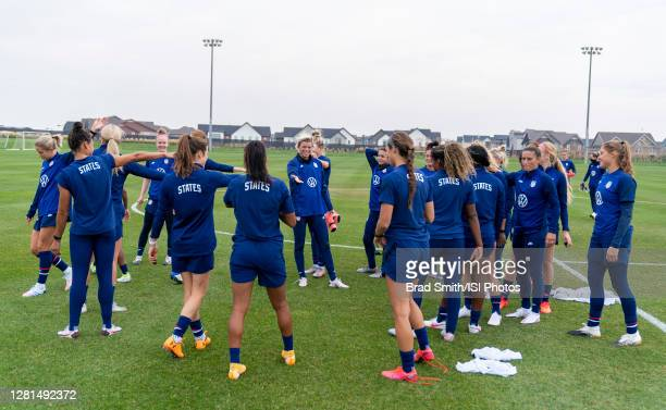 The USWNT huddles before a training session at Dick's Sporting Goods Park training fields on October 20 2020 in Commerce City Colorado