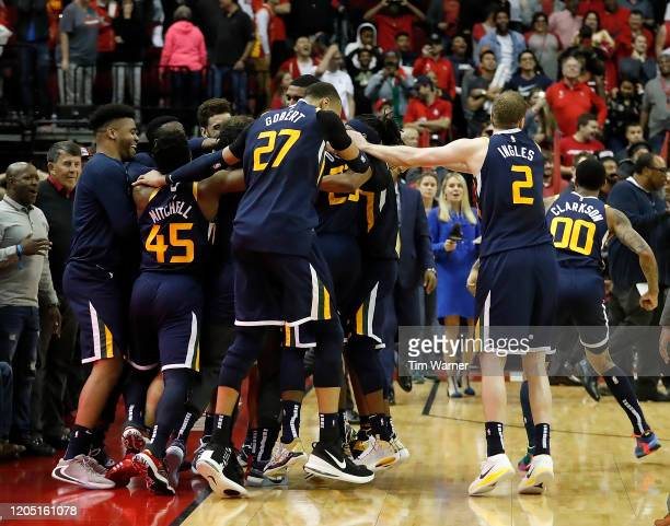 The Utah Jazz players celebrate a victory on a last second basket by Bojan Bogdanovic to defeat the Houston Rockets at Toyota Center on February 09,...
