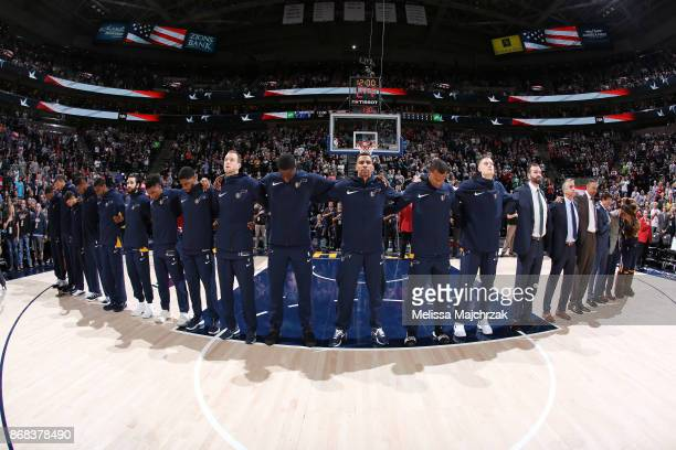 The Utah Jazz stand for the National Anthem before the game against the Dallas Mavericks on October 30 2017 at Vivint Smart Home Arena in Salt Lake...