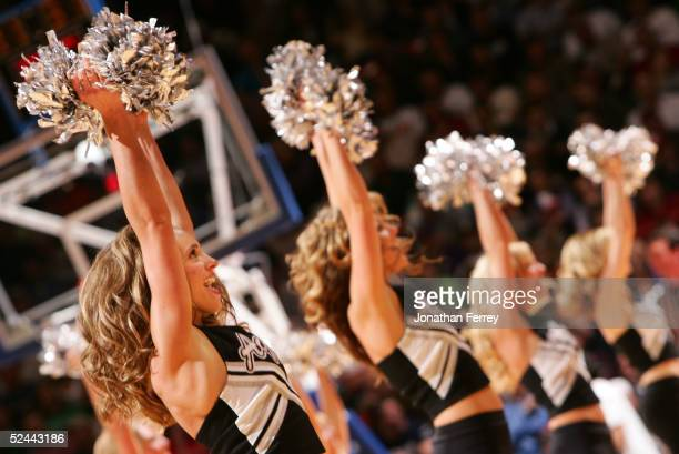 The Utah State Aggies cheerleaders performs during a break from the 2005 NCAA division 1 men's basketball championship tournament game against the...