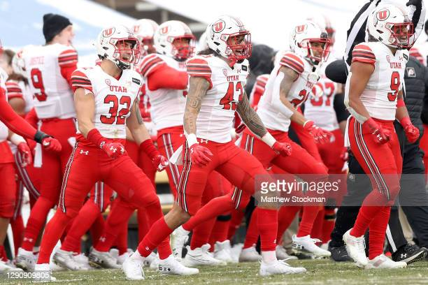 The Utah Utes celebrate a fourth down defensive stop against the Colorado Buffaloes in the fourth quarter at Folsom Field on December 12, 2020 in...