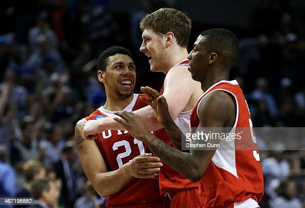 The Utah Utes celebrate their 75 to 64 win over the Georgetown Hoyas during the third round of the 2015 NCAA Men's Basketball Tournament at Moda...