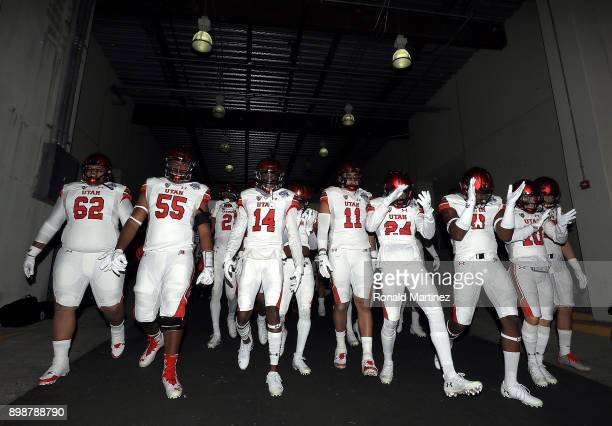 The Utah Utes walk to the field before Zaxby's Heart of Dallas Bowl against the West Virginia Mountaineers on December 26 2017 at Cotton Bowl in...