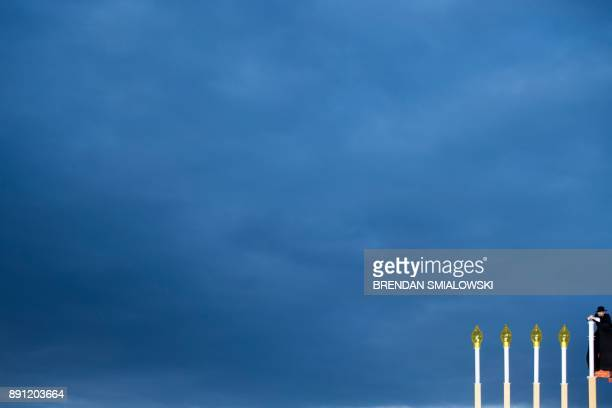 The utility candle is lit during the National Chanukah Menorah lighting on the Ellipse December 12 2017 in Washington DC / AFP PHOTO / Brendan...